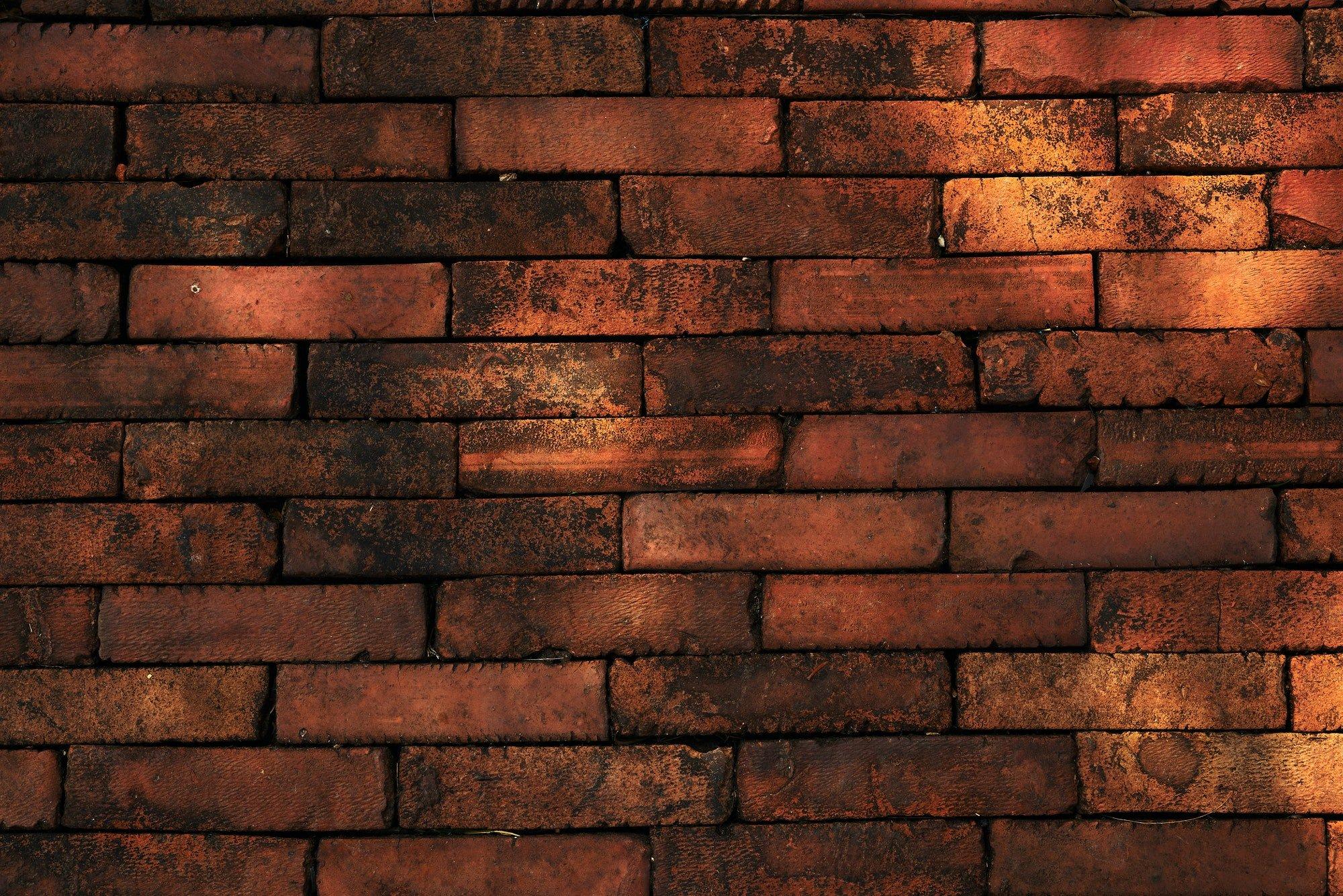 Background of the rough orange brick wall